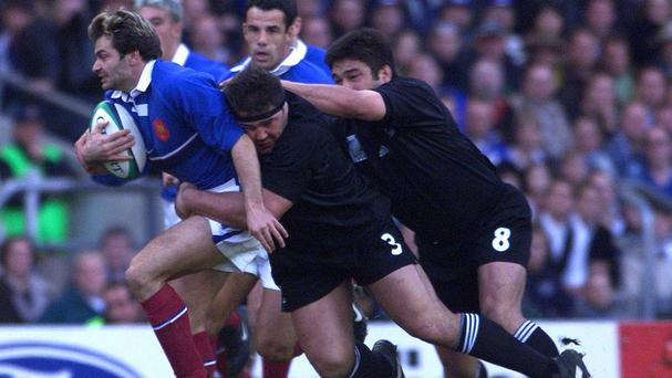 France wing Christophe Dominici on the charge against 1999 World Cup semi-final opponents New Zealand at Twickenham