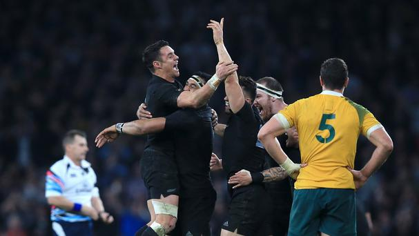 New Zealand's Daniel Carter (left) celebrates with teammates after the Rugby World Cup Final at Twickenham, London.