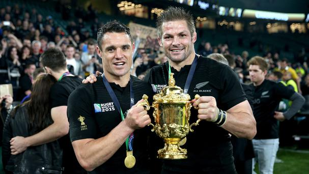 Dan Carter, left, and Richie McCaw celebrate with the Webb Ellis trophy