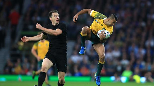 Kurtley Beale, right, has come to typify Australia's resurgence under head coach Michael Cheika
