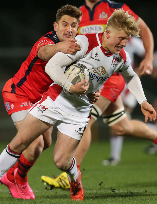 Hold on: Ulster's Robert Lyttle is caught by George Watkins
