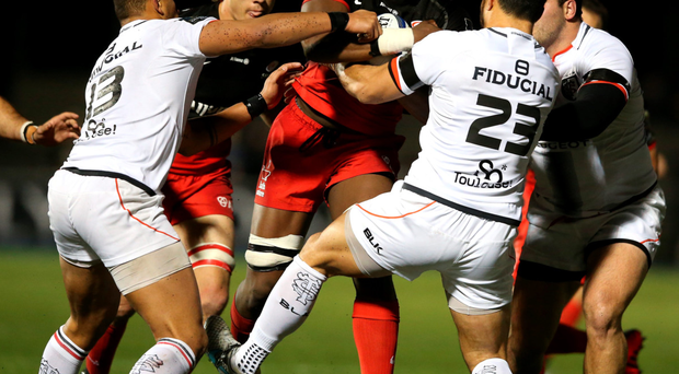 Battering ram: Maro Itoje of Saracens is tackled by Yann David (right) and Gael Fickou