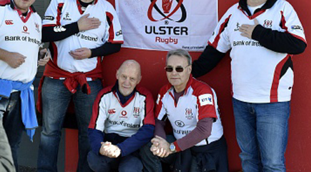 Act of remembrance: Ulster fans who travelled to France leave a flag for Paris at Oyonnax