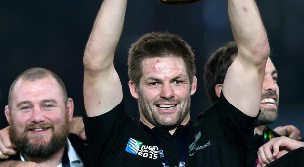 World beater: Richie McCaw lifts his second World Cup