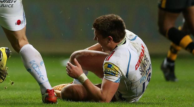 Exeter Chiefs' Henry Slade lies on the pitch with an injury during the win over Wasps