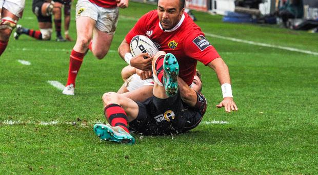 So close: Munster's Simon Zebo is tackled by Newport Gwent Dragons' Tom Prydie just short of the try line