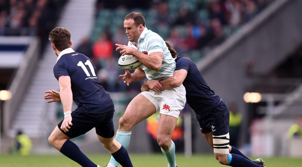 Cambridge University centre Jamie Roberts (centre) limped off at half time with a dead leg