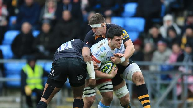 Cardiff Blues back-rower Ellis Jenkins, pictured centre, has signed a new long-term deal