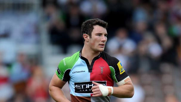 Centre George Lowe has signed a new Harlequins deal.