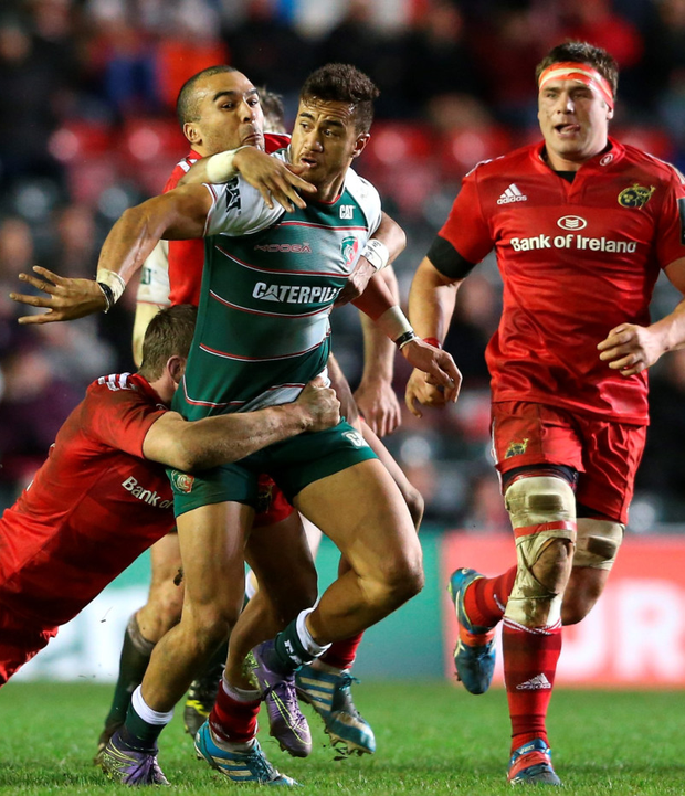 Munster mash: Simon Zebo and Denis Hurley surround and tackle Leicester's Peter Betham