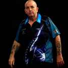 Power surge: Phil Taylor is relieved to taste victory