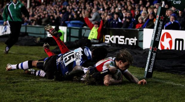 BATH, ENGLAND - JANUARY 23: Andrew Trimble of Ulster dives over to score a try during the Heineken Cup round six match between Bath Rugby and Uslter Rugby at the Recreation Ground on January 23, 2010 in Bath, England. (Photo by Warren Little/Getty Images)