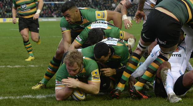 Northampton's Mike Haywood drives over for the game's only try