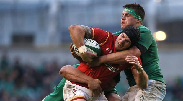 CJ Stander (right) made his debut for Ireland against Wales