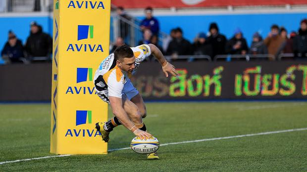 Jimmy Gopperth crosses for one of Wasps' eight tries