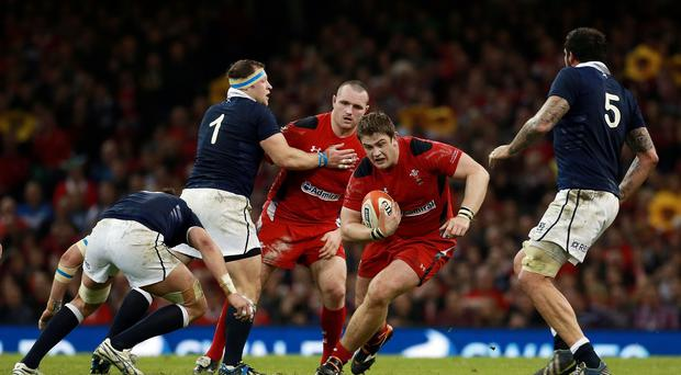 Wales prop Rhodri Jones will join the Ospreys from the Scarlets at the end of the season.