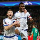 Chelsea's John Obi Mikel (right) celebrates his crucial strike with Gary Cahill