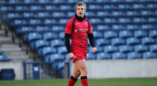 Tom Brown has extended his Edinburgh stay