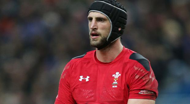 Lock Luke Charteris will miss Wales' RBS 6 Nations clash against France on Friday because of a knee injury