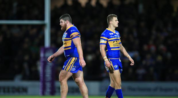 Mitch Garbutt (pictured left on his way to the sidelines after being sent off for punching) has apologised for his actions