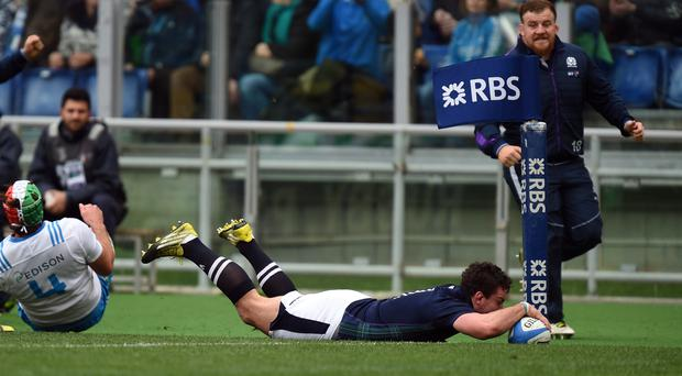 Scotland's John Hardie dives in to score his side's second try against Italy during the RBS Six Nations match at the Stadio Olimpico