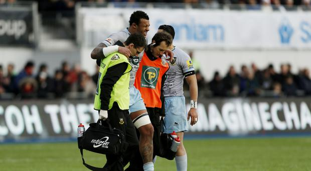 Courtney Lawes goes off with an injury during at Saracens