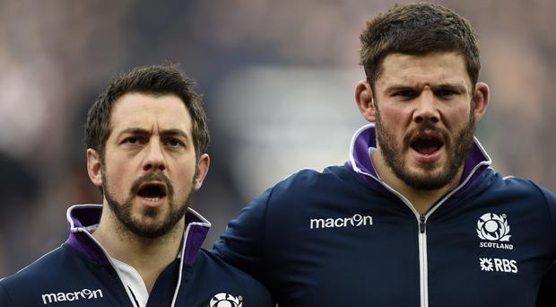 Scotland skipper Greig Laidlaw (left) should be counted among the nation's greatest captains, according to team-mate Ross Ford (right)
