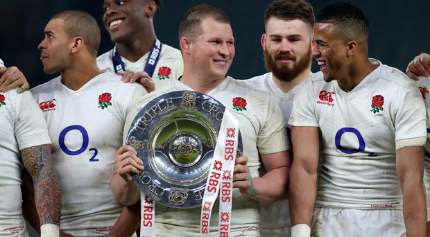 England's Dylan Hartley with the triple crown trophy