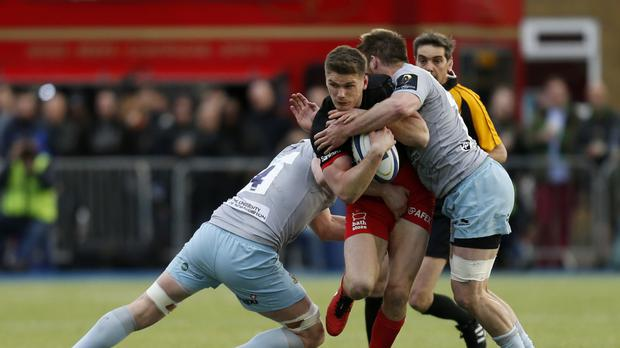 Saracens' Owen Farrell is tackled during the clash with Northampton