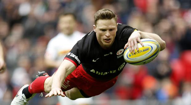 Saracens' Chris Ashton scores one of his two tries against Harlequins at Wembley