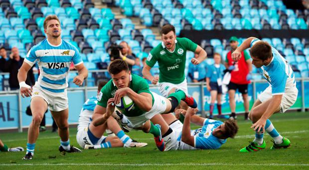 Over and out: Jacob Stockdale scores the first try at the City Academy Stadium against Argentina