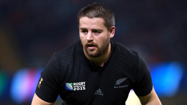 Hurricanes captain Dane Coles left the field looking in pain early in the second half