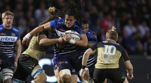 TJ Ioane, pictured centre, has signed a new contract at Sale