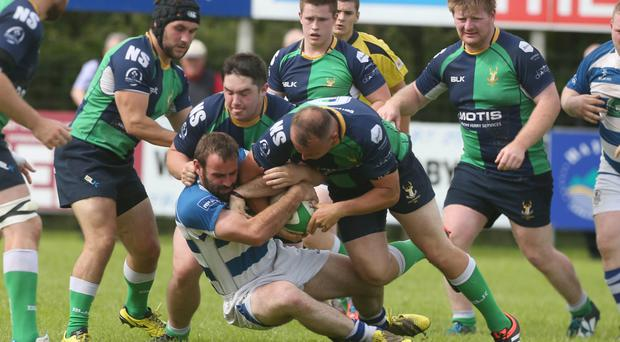 My ball: Dungannon's James McMahon and Hinch's Keith Dixon get to grips during the visiting side's victory at Stevenson Park