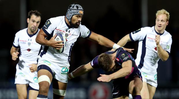 Clermont Auvergne's Fritz Lee is tackled by Exeter's Ollie Devoto
