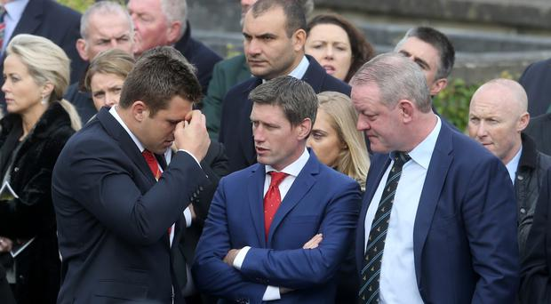 Ronan O'Gara (centre) at Anthony Foley's funeral in Killaloe last week