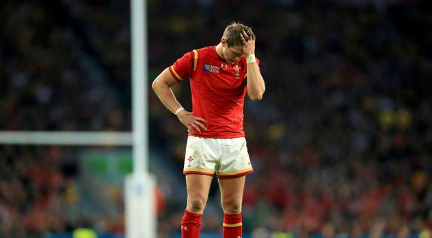 Wales' Dan Biggar stands dejected after the 2015 World Cup defeat to Australia
