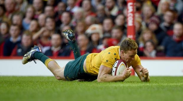 Reece Hodge goes in for one of Australia's tries.