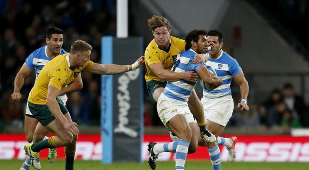 Australia's Michael Hooper was sin-binned for this high tackle on Argentina's Matias Orlando in October but World Rugby want this kind of offence punished with a red card