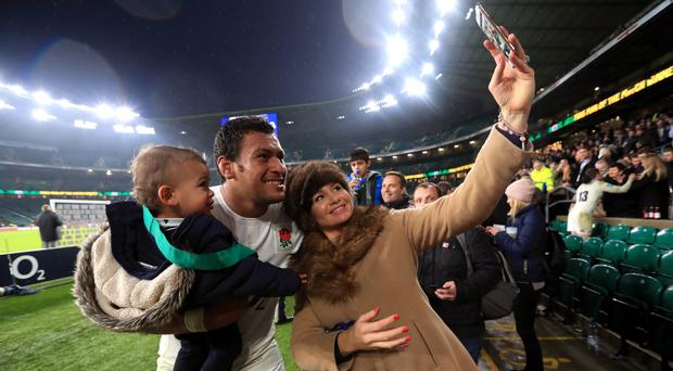 Nathan Hughes, centre, said his decision to play for England is to support his family