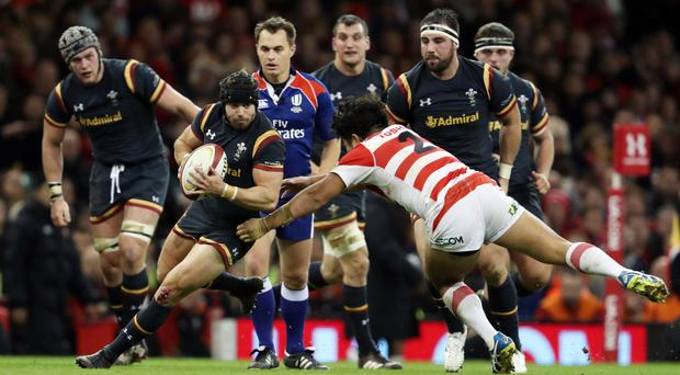 Leigh Halfpenny, carrying the ball, put in a solid display for Wales