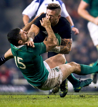 Hands on: Ireland ace Rob Kearney does his best to halt New Zealand's TJ Perenara at the Aviva