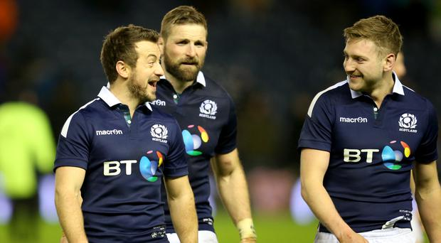 Finn Russell, right, and Greig Laidlaw, left, could afford to laugh after Scotland's late win