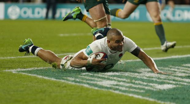 Jonathan Joseph scores the last of England's four tries, his second
