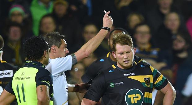 Northampton Saints' Dylan Hartley is shown a red card