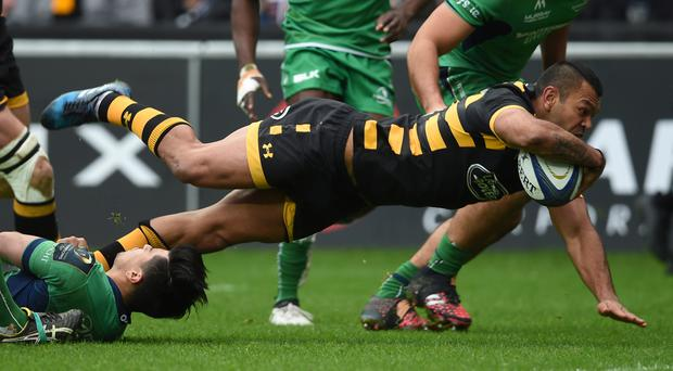 Kurtley Beale dives over for the opening try on his Wasps debut