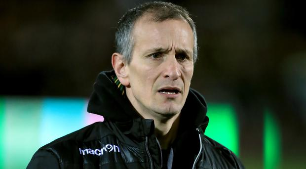 Alan Dickens' Northampton kept alive their chances of reaching the semi-finals by running in eight tries
