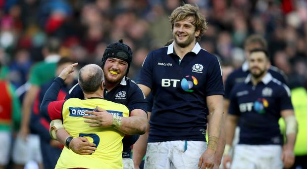 Scotland's Zander Fagerson, left, celebrates their opening triumph