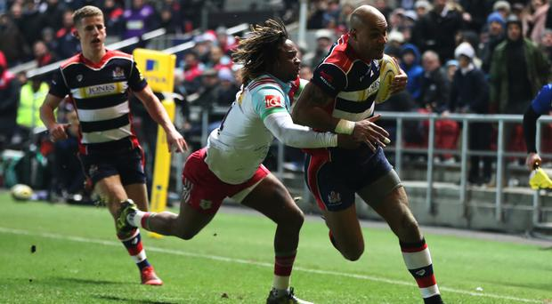 Bristol's Tom Varndell charges through to score his record-breaking try