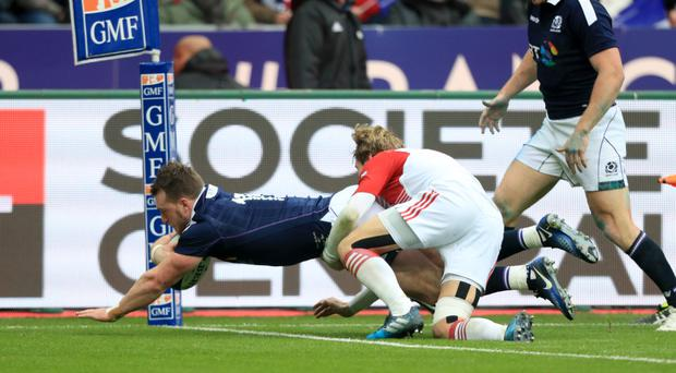 Scotland's Stuart Hogg dives in to score a try for Scotland